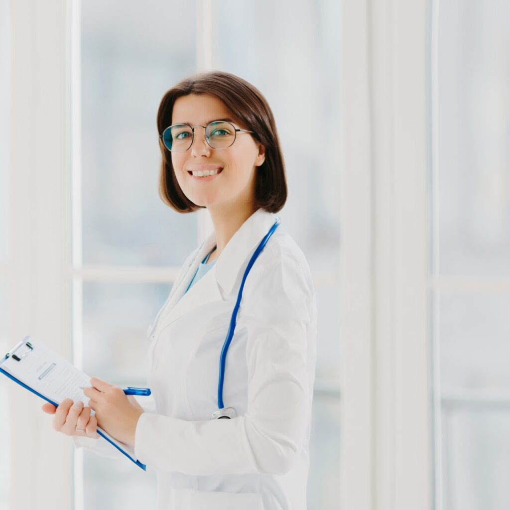 doctor-smiling-while-holding-her-physician-cv